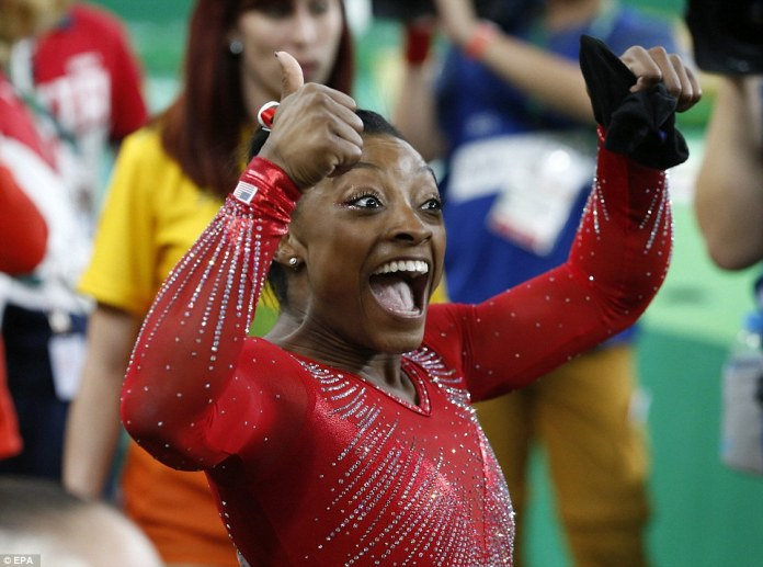 373ABC0F00000578-3740326-Celebration_Simone_Biles_reacts_to_the_news_she_has_picked_up_he-a-28_1471209576983